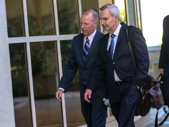 David Gibson, left, the former chief financial officer at Wilmington Trust, arrives at the J. Caleb Boggs Federal Building in October 2017.