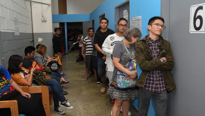 The line for driver's license applicants and renewals stretches around the corner at the Guam Department of Revenue and Taxation in Barrigada on Sept. 8, 2017.