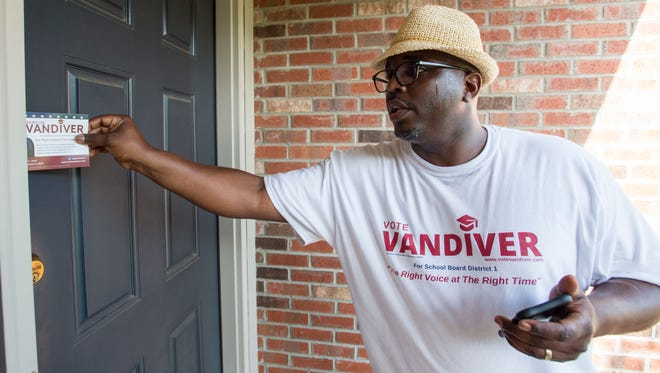 Marcus Vandiver, democratic candidate for Montgomery School Board District 1, campaigns to win the runoff, June 19, 2018, in the Stoney Brook neighborhood in Montgomery, Ala.
