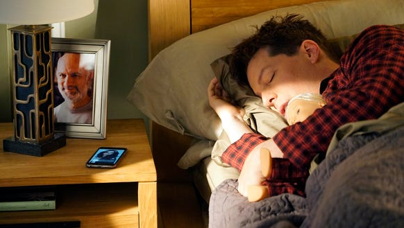 Sean Hayes, who sleeps with a doll, is awakened to
