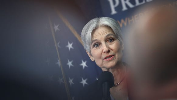 Jill Stein answers questions during a press conference