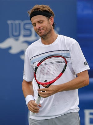 Mardy Fish of the US reacts against Dudi Sela of Israel during a first round match at the BB&T Atlanta Open tennis tournament at Atlantic Station