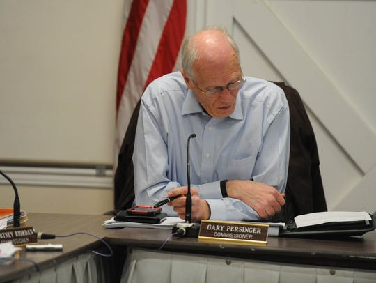 In this file photo, Commissioner Gary Persinger listens as the Dewey Town Commissioners discuss the final draft of the town audit on Monday, March 26, 2018.