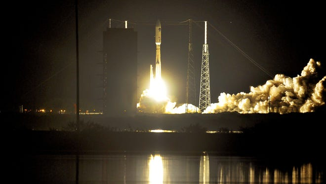 A United Launch Alliance Atlas V rocket roars off its Cape Canaveral launch pad on Tuesday, Jan. 20, 2015.