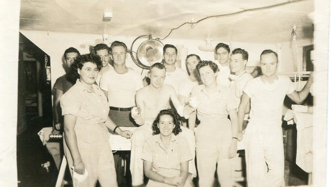 In the burn unit aboard the U.S.S. Mercy. Vera Rauh is at front row, left.