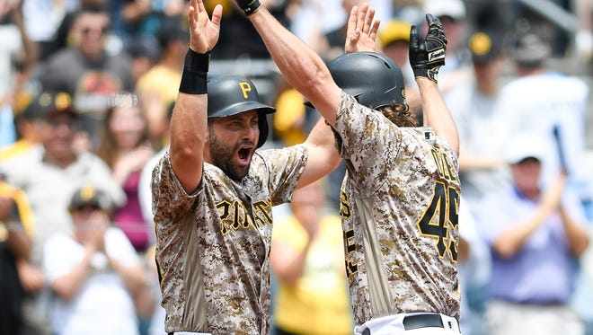 After hitting a three-run home run, Gerrit Cole of the Pittsburgh Pirates celebrates with Francisco Cervelli in the second inning against the Arizona Diamondbacks at PNC Park on May 26, 2016 in Pittsburgh.
