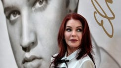 Priscilla Presley glances at a crowd of fans after