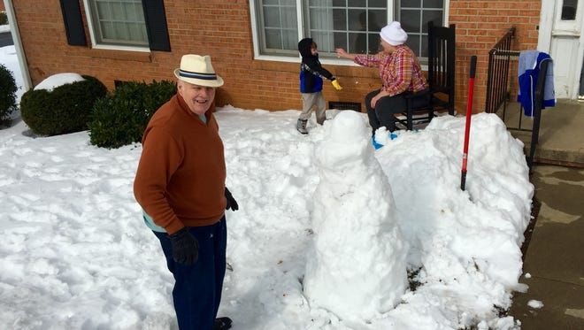 Jack and Barbara Rowe spend the afternoon playing in the snow with their grandson, Tye Demopolus.