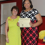 Susan Whitcomb, left, president of the Pine Belt chapter of the Phi Delta Kappa education honor society and associate professor of education at William Carey University, poses with Jennifer Dixon, Teacher of the Year for Rowan Elementary School in Hattiesburg, at the chapter's May 5 dinner honoring area Teachers of the Year.