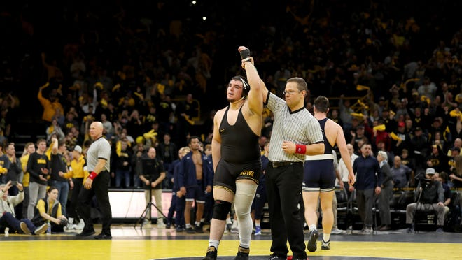 Iowa heavyweight Tony Cassioppi has his hand raised after beating Penn State's Seth Nevills on Jan. 31, 2020, at Carver-Hawkeye Arena. Cassioppi finished last season 20-3 and took third at the Big Ten Championships.