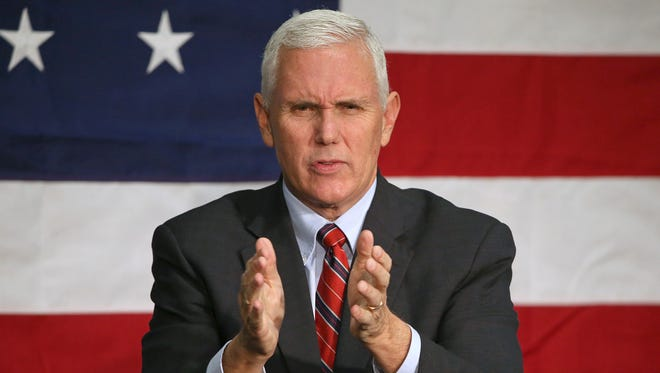 Indiana Gov. Mike Pence, the Republican nominee for vice president, thanks the crowd after speaking at the Allen County War Memorial Coliseum, Fort Wayne, Ind., Friday, September 30, 2016.