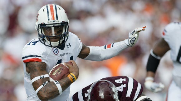 Nick Marshall will lead Auburn into its third road game against a ranked opponent Saturday at No. 7 Ole Miss.