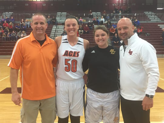Amanda-Clearcreek coach Cary James, Maddie Snider, Bloom-Carroll's Alexis Burchfield and Liberty Union coach Adam Twiss participated in the District 11 All-Stae game Friday night at Newark High School.