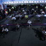 Hand cyclists leave the starting line during for the beginning of the 37th Annual Detroit Free Press/Talmer Bank Marathon.