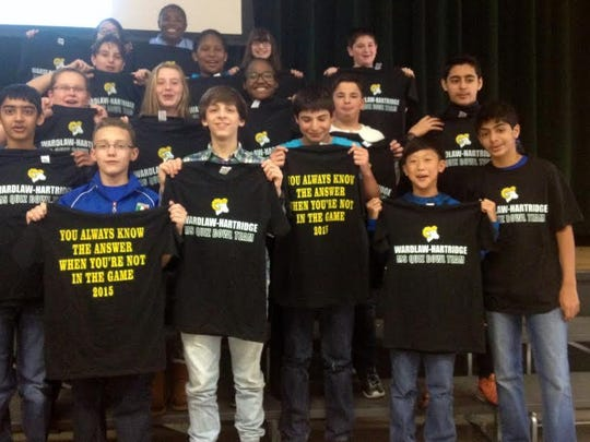 Members of the Seventh-Grade Quiz Bowl Team at The Wardlaw-Hartridge School in Edison show off their T-shirts after participating in this year's competition. The team finished 13th in the National Seventh Grade Quiz Bowl Competition. Team members are Logan Hill of Dayton, Ricardo Garces of North Brunswick, Ryan Brace of Scotch Plains, AJ Massaro of South Plainfield, Jane Anderson-Schmitt of Scotch Plains, Svanik Dani of Edison, Lowy Shim of Warren, Logan D'Amore of Scotch Plains, Sahil Mulji of Edison, Sydney Johnson of Piscataway, Shane Kornecki of Colonia, Anna O'Connell of Plainfield, Janeyce McCray of Union, Neha Sharma of Edison, Sohum Thakker of Parlin, Jake Rothstein of Woodbridge and Robert Brandl of Plainfield.