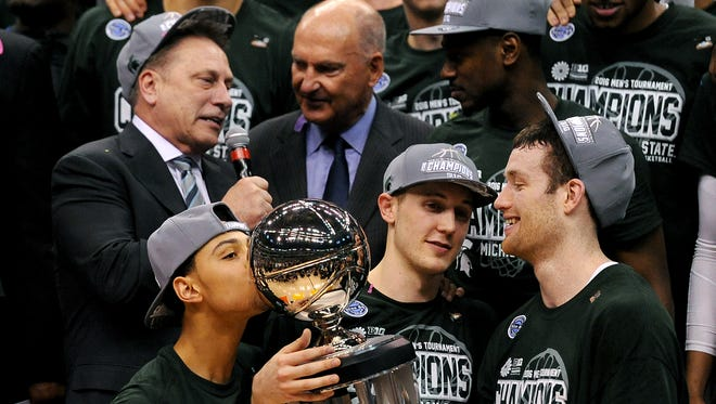 Michigan State senior guard Bryn Forbes (5) kisses the Big Ten Tournament trophy after MSU's 66-62 win over Purdue in the Big Ten Tournament Championship game, Sunday, March, 13, 2016 at Bankers Life Fieldhouse in Indianapolis.