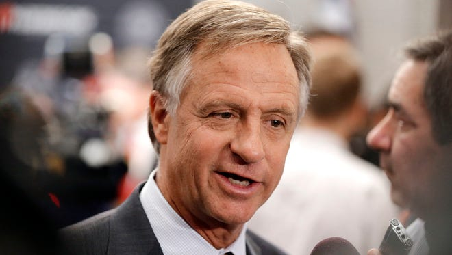 In this April 13, 2016, photo, Tennessee Gov. Bill Haslam talks with reporters in Nashville. On Monday, May 2, 2016, Haslam said he is allowing a controversial guns-on-campus bill to become law without his signature.