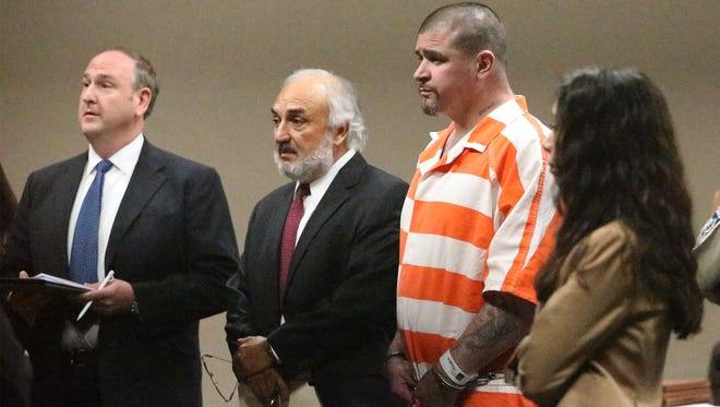 John Paul Perry stands before Judge Luis Aguilar during his arraignment in June in 243rd District Court. To his left is his lead attorney, Joe Spencer, and to his right is prosecutor Rebecca Tarango.