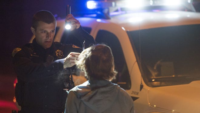 Fort Collins Police Services Officer Andrew Edmonds conducts a roadside sobriety test on a driver suspected of DUI in February.