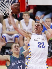 Rice Lake's Henry Ellenson (22) shoots against Greendale's Tommy Kujawa during the first half of their Division 2 semifinal.