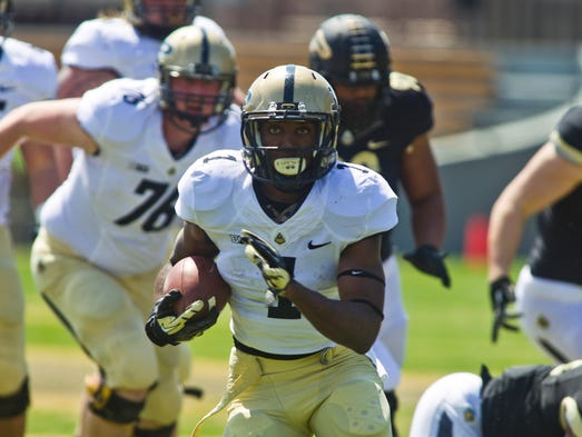 Purdue running back Akeem Hunt looks for room against the black team during the annual spring game Saturday, April 12, 2014, at Ross-Ade Stadium in West Lafayette.