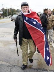 David Tillery of Tuscaloosa, Ala., walks away from