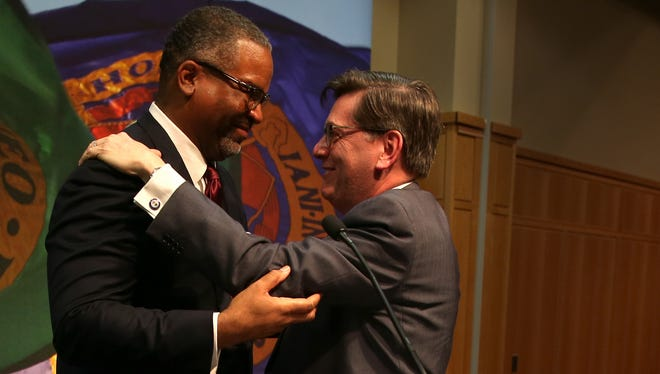 Gregory Vincent is embraced by Hobart and William Smith Colleges President Mark D. Gearan on Thursday. Gearan announced that Vincent would become the 27th president of Hobart College and the 16th of William Smith College.