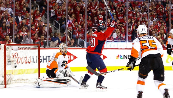 Capitals center Marcus Johansson celebrates after John Carlson's goal Saturday against Flyers goalie Steve Mason in the first period in game two of the first round of the 2016 Stanley Cup Playoffs at Verizon Center.