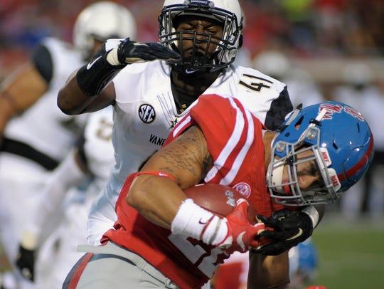 Vanderbilt linebacker Zach Cunningham (41) tackles