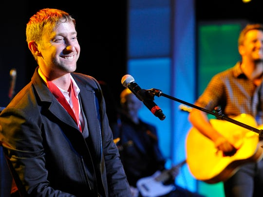 Songwriter Ashley Gorley smiles as he performs with Luke Bryan at the 53rd Annual ASCAP Country Music Awards Monday Nov. 2, 2015, in Nashville, Tenn.