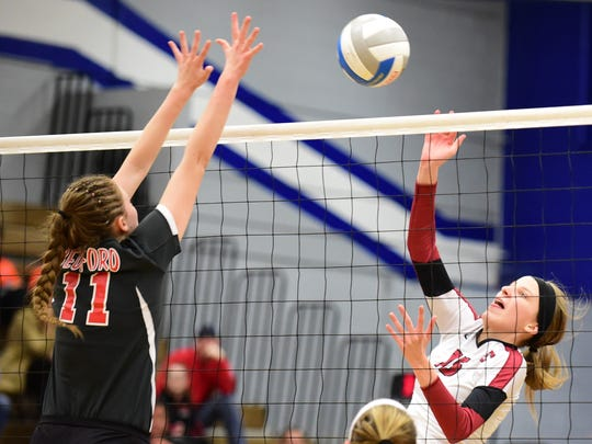 Churchill's Summer Clark (15) tries to avoid the block of Bedford's Joella Griner.