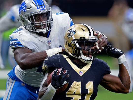 Lions linebacker Jarrad Davis commits a facemask penalty on Saints running back Alvin Kamara in the second half in New Orleans, Sunday, Oct. 15, 2017. The Saints won, 52-38.