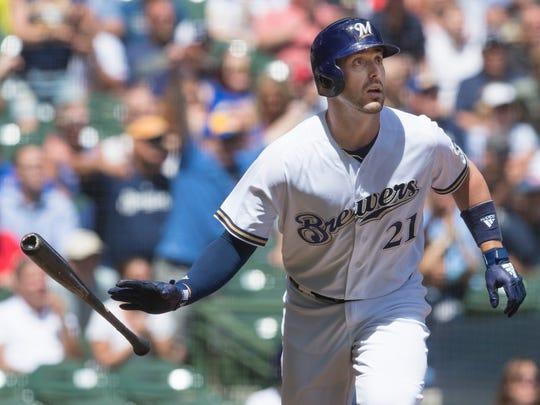 Travis Shaw watches his three-run home run, his 12th of the season.