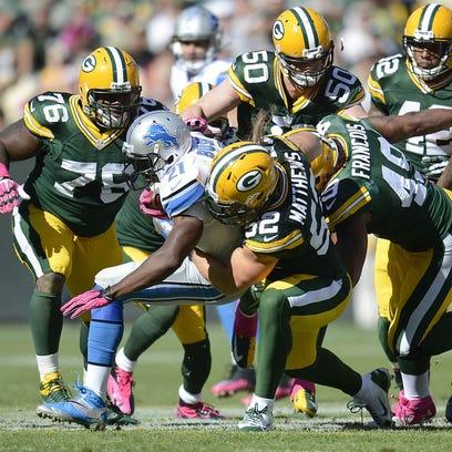 Green Bay Packers linebacker Clay Matthews stuffs Detroit