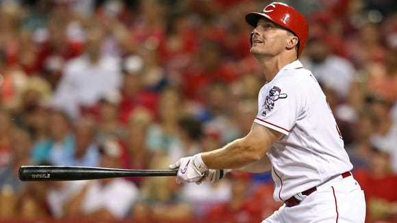 The Reds' Jay Bruce watches his double in the fifth