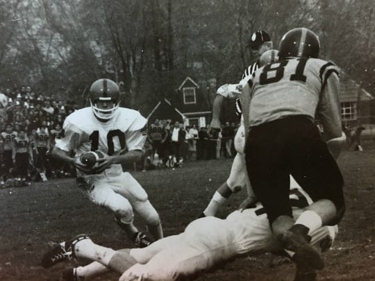 """Tenafly's Rob Nelson (10) running behind textbook block by Bill """"Trip"""" Risely."""