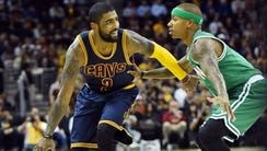 Cleveland Cavaliers guard Kyrie Irving (2) dribbles
