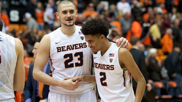 Feb 6, 2016; Corvallis, OR, USA; Oregon State University Beavers center Gligorije Rakocevic (23) and guard Stephen Thompson Jr. (2) celebrate after a game against the University of Colorado Buffaloes at Gill Coliseum. The Beaver won 60-56. Mandatory Credit: Troy Wayrynen-USA TODAY Sports