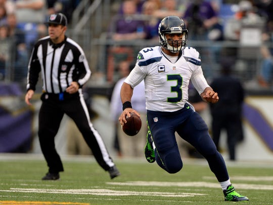 Dec 13, 2015; Baltimore, MD, USA;  Seattle Seahawks quarterback Russell Wilson (3) scrambles during the second half against the Baltimore Ravens at M&T Bank Stadium. Seattle Seahawks defeated Baltimore Ravens 35-6.  Mandatory Credit: Tommy Gilligan-USA TODAY Sports