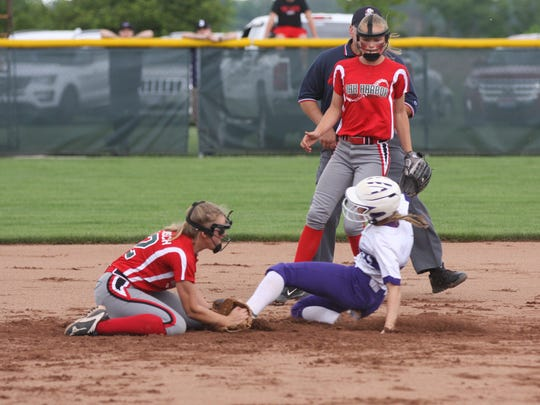 Oak Harbor's Kaytlynn Sandwisch tags Keystone's Ali Pyles out at second Saturday after a throw from catcher Maddy Rathbun.