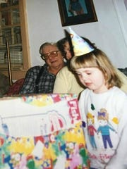My grandpa and I at a birthday party.