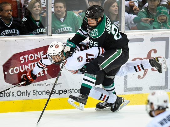 St. Cloud State's Dennis Cholowski is checked off the