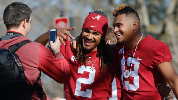 Alabama quarterbacks Jalen Hurts, left, and Tua Tagovailoa have their picture taken during the NCAA college football national championship parade, Saturday, Jan. 20, 2018, in Tuscaloosa, Ala. Alabama won the national championship game against Georgia 26-23 in overtime.