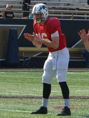 Western Michigan quarterback Jon Wassink (16).