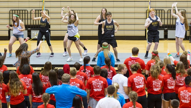 Purdue University Dance Marathon team performs the morale dance that the participants will learn through the evening. The Avon High School Riley Dance Marathon was held Saturday, April 19, 2014, benefitting Riley Hospital for Kids.