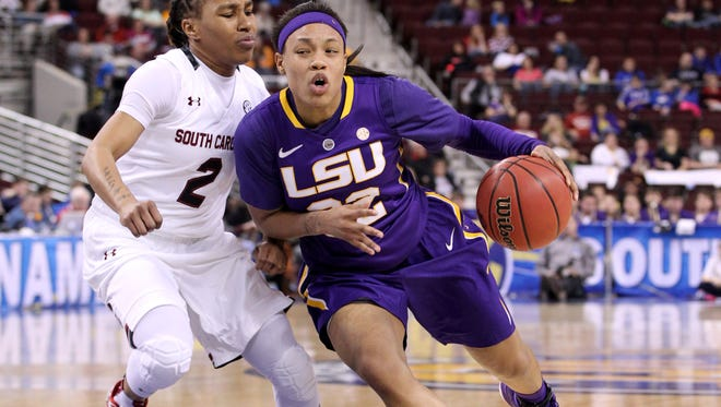 LSU Lady Tigers guard Danielle Ballard (32) drives against South Carolina Gamecocks guard Olivia Gaines (2) in the first half during the semifinals of the SEC Women's Tournament at Verizon Arena in Little Rock, Ark.