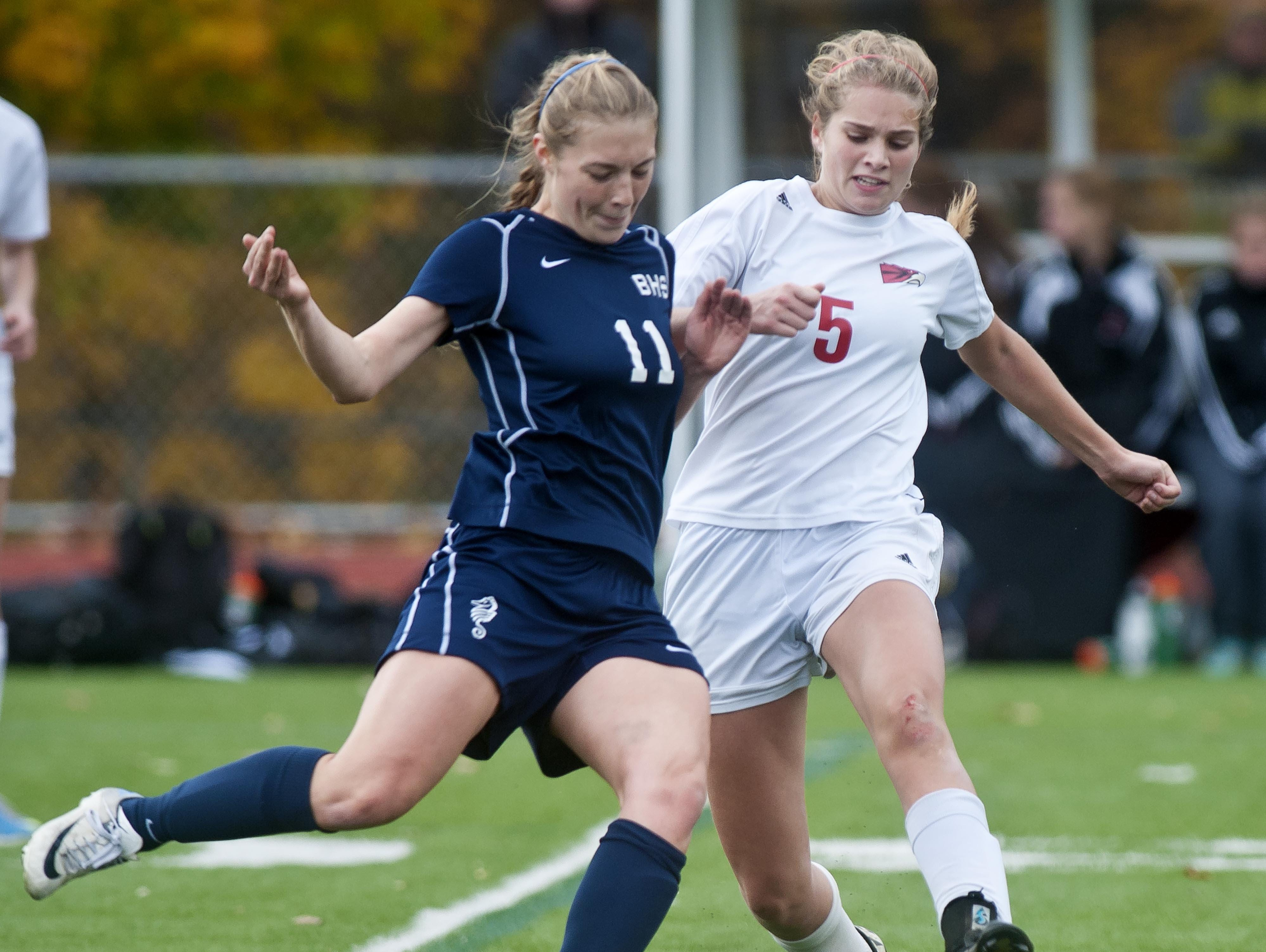 CVU's Paige Dubrul (right) and Burlington's Callie Flynn try to get a foot on the ball during the Division I high school girls state championship in November.