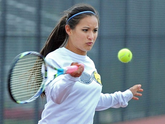 Sisters Jackie (pictured) and Jade Kawamoto play tennis at Greenwood High School. Jackie, the defending state champion has given up the number one spot on the team to her sister to give her a chance to contend for the state title.