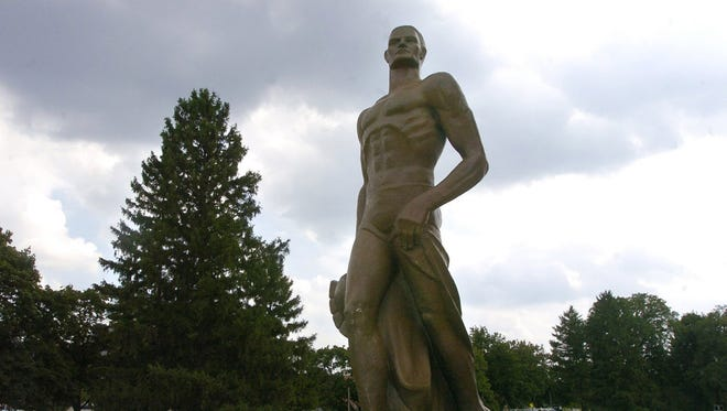 The bronze Sparty statue is shown after being mounted on the campus of Michigan State University in East Lansing on Aug. 10, 2005.
