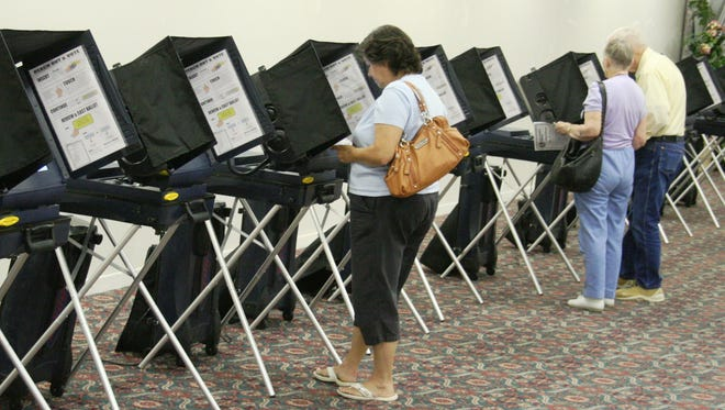 Nevada voters cast a ballot in the 2014 election.